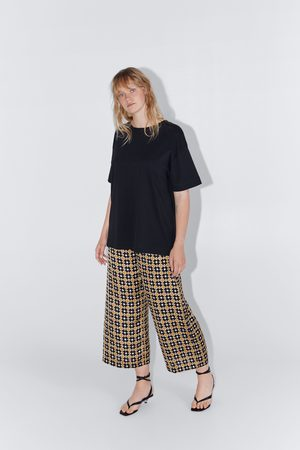 Zara Luźne spodnie z nadrukiem