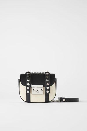 Zara Kobieta Listonoszka - Płócienna mini torebka listonoszka w stylu rockowym