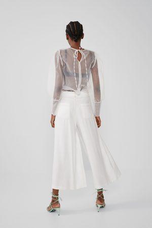 Zara Spodnie o krótszym kroju z przeszyciami