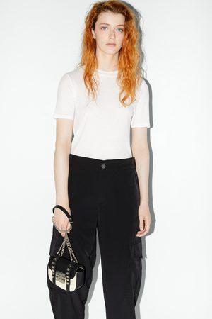 Zara Płócienna mini torebka listonoszka w stylu rockowym