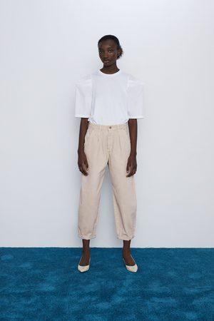 Zara Kobieta Jeansy - Spodnie jeansowe z zaszewkami typu slouchy z kolekcji z1975