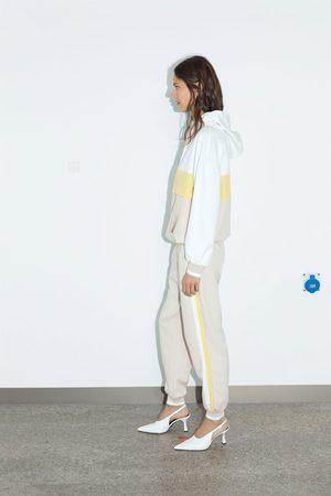 Zara Kobieta Spodnie dresowe - Spodnie joggery z lampasami po bokach