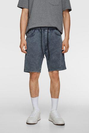 Zara Bermudy z przyjemnej w dotyku tkaniny jeansowej