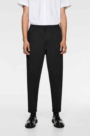 Zara Spodnie joggery typu traveler