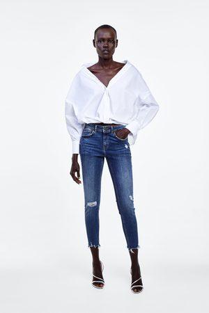 Zara Spodnie jeansowe rurki ze średnim stanem i rozdarciami z kolekcji z1975