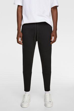 Zara Mężczyzna Spodnie dresowe - Spodnie joggery z suwakami