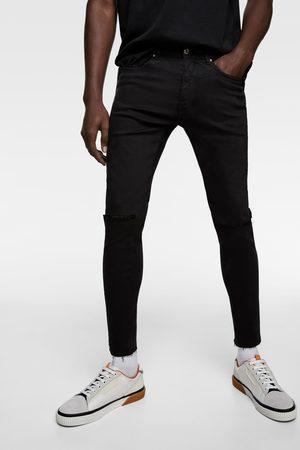 Zara Mocno dopasowane spodnie jeansowe rurki z rozdarciami
