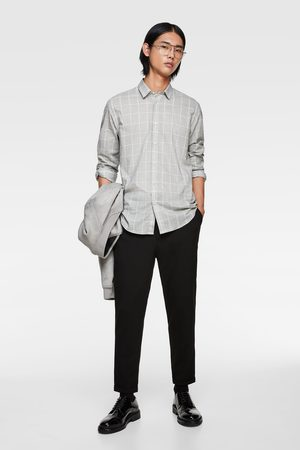 Zara Spodnie o kroju marchewkowym z łańcuszkiem