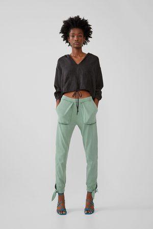 Zara Spodnie z efektem sprania i kieszeniami