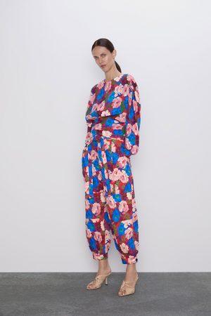 Zara Spodnie z nadrukiem w kwiaty i paskiem