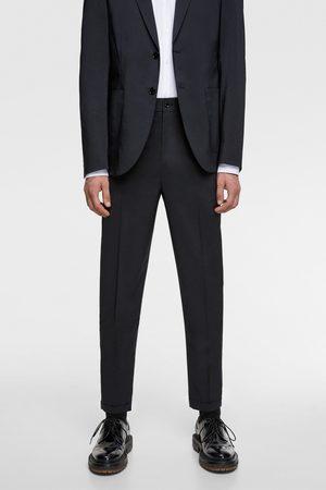 Zara Mężczyzna Spodnie - Spodnie od garnituru z kolekcji traveler