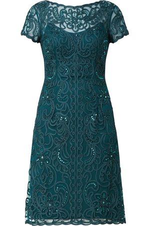 Luxuar Kobieta Sukienki koktajlowe i wieczorowe - Sukienka koktajlowa z siateczki z ozdobnymi tasiemkami