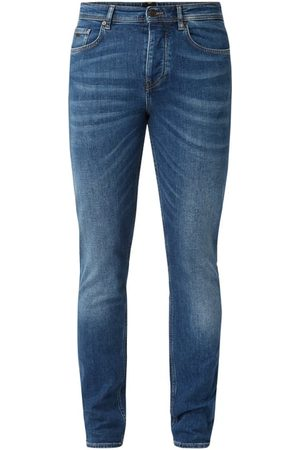 HUGO BOSS Jeansy w dekatyzowanym stylu o kroju tapered fit