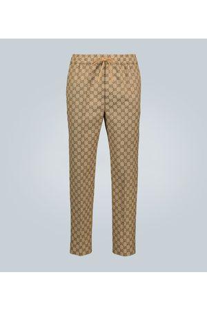 Gucci Spodnie - GG canvas jacquard jogging pants