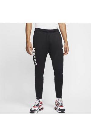 Nike Mężczyzna Dresy - Męskie spodnie piłkarskie F.C. Essential