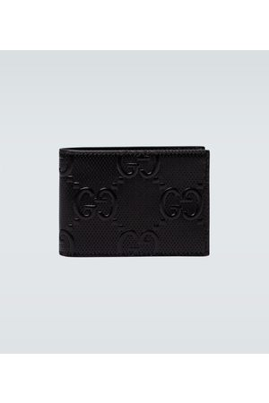 Gucci Portmonetki i Portfele - GG embossed leather wallet