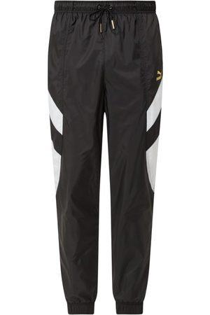 Puma Dresy - Spodnie treningowe z paskami z logo