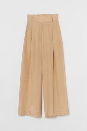 H&M Spodnie palazzo z jedwabiem