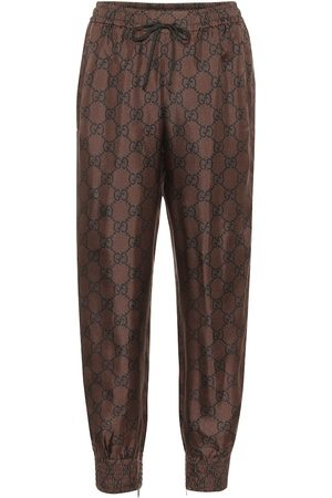 Gucci GG Supreme silk-twill trackpants