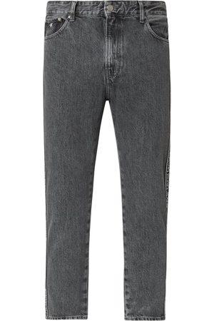 Calvin Klein Jeansy o kroju dad fit z paskami z logo
