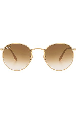 Ray-Ban Round Metal in - Metallic Gold. Size all.
