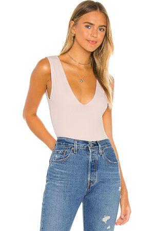 Free People Keep It Sleek Bodysuit in - Blush. Size L (also in M, XS, S).