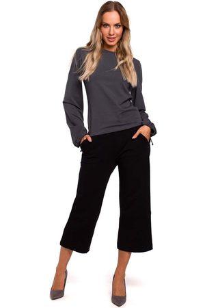 MOE Czarne spodnie dzianinowe 7/8 z szerokimi nogawkami