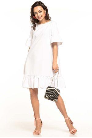 Tessita Biała luźna letnia sukienka wykończona falbankami