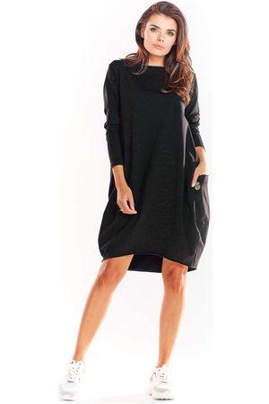 Infinite you Czarna bawełniana luźna sukienka z długim rękawem