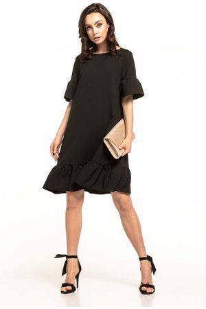 Tessita Czarna luźna letnia sukienka wykończona falbankami