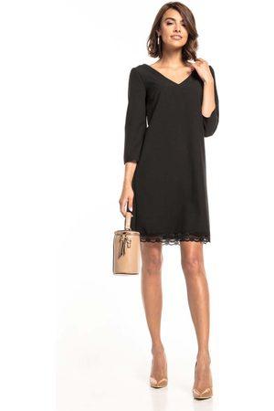 Tessita Czarna sukienka o kroju litery a z koronką