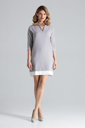 Figl Kobieta Sukienki koktajlowe i wieczorowe - Prosta szara sukienka z rękawem 3/4 z kontrastową wypustką na dole