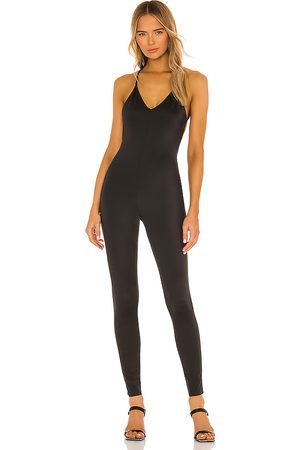 Norma Kamali Low Back Fara Slip Catsuit in - . Size L (also in M, S, XS).