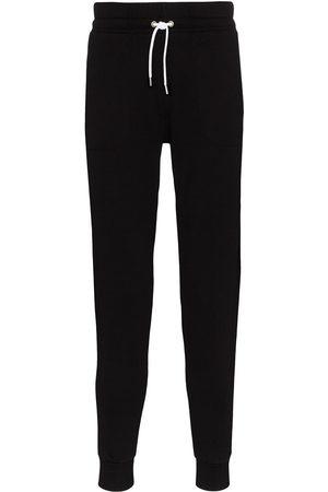 Maison Kitsuné Mężczyzna Spodnie dresowe - Black