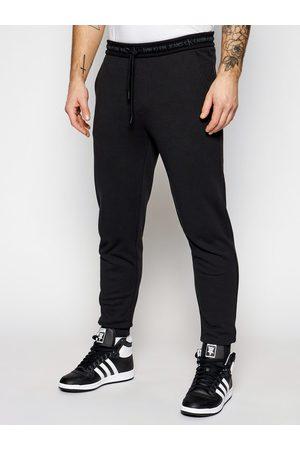 Calvin Klein Spodnie dresowe J30J317196 Regular Fit