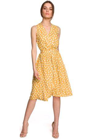 Moe Kobieta Sukienki bez rękawów - Rozkloszowana sukienka w grochy bez rękawów - żółta