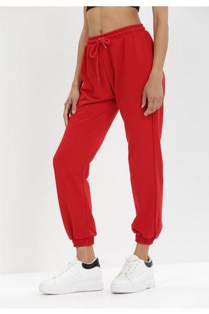 BORN2BE Czerwone Spodnie Dresowe Antheis