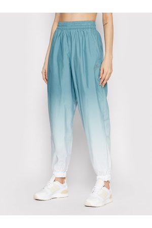 adidas Spodnie dresowe adicolor 3D Trefoil GN2850 Loose Fit