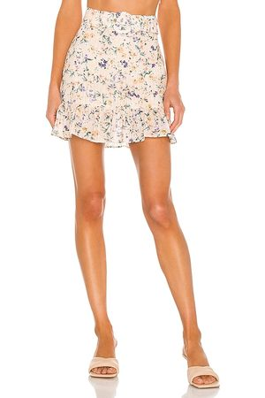 Lovers + Friends Jill Mini Skirt in - Peach. Size L (also in XXS, XS, S, M, XL).