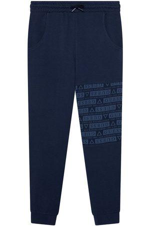Guess Spodnie dresowe L1YQ11 KA6R0 Granatowy Regular Fit