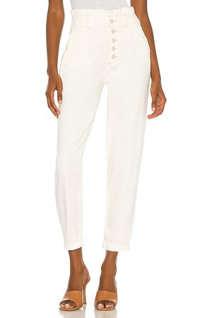 Paige Pleated Carrot Leg Exposed Buttonfly Jean in - White. Size 25 (also in 26, 27, 29, 30, 31).