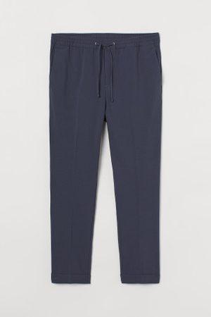 H&M Mężczyzna Spodnie dresowe - Joggersy Slim Fit