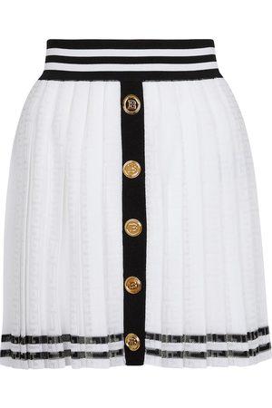 Balmain Kobieta Spódnice plisowane - Pleated monogram knit miniskirt