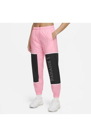 Nike Kobieta Dresy - Damskie spodnie piłkarskie z tkaniny Paris Saint-Germain