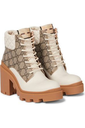 Gucci Kobieta Botki - GG Supreme and leather ankle boots