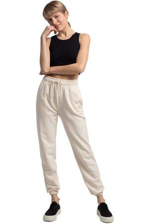MOE Kobieta Dresy - Wiązane w pasie spodnie joggersy z haftowanym wilkiem - waniliowe