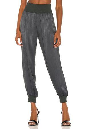 Bobi BLACK Sleek Textured Pant in - Dark Green. Size XS (also in S, M, L).