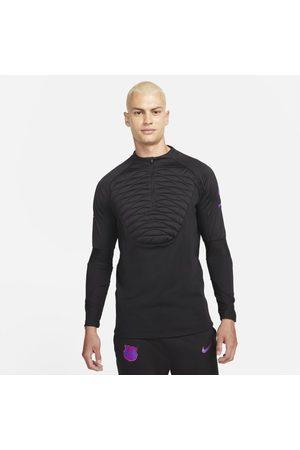 Nike Mężczyzna Sportowe Topy i T-shirty - Męska treningowa koszulka piłkarska Therma-FIT FC Barcelona Strike Winter Warrior - Czerń