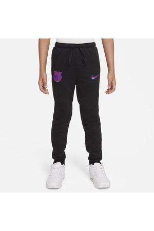 Nike Dresy - Spodnie piłkarskie z dzianiny dla dużych dzieci FC Barcelona Dri-FIT - Czerń