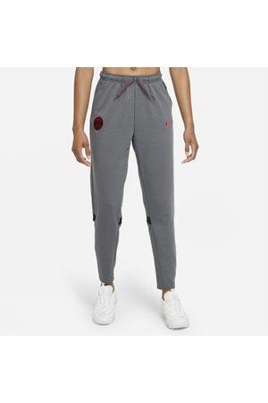 Nike Kobieta Dresy - Damskie piłkarskie spodnie podróżne z dzianiny Paris Saint-Germain